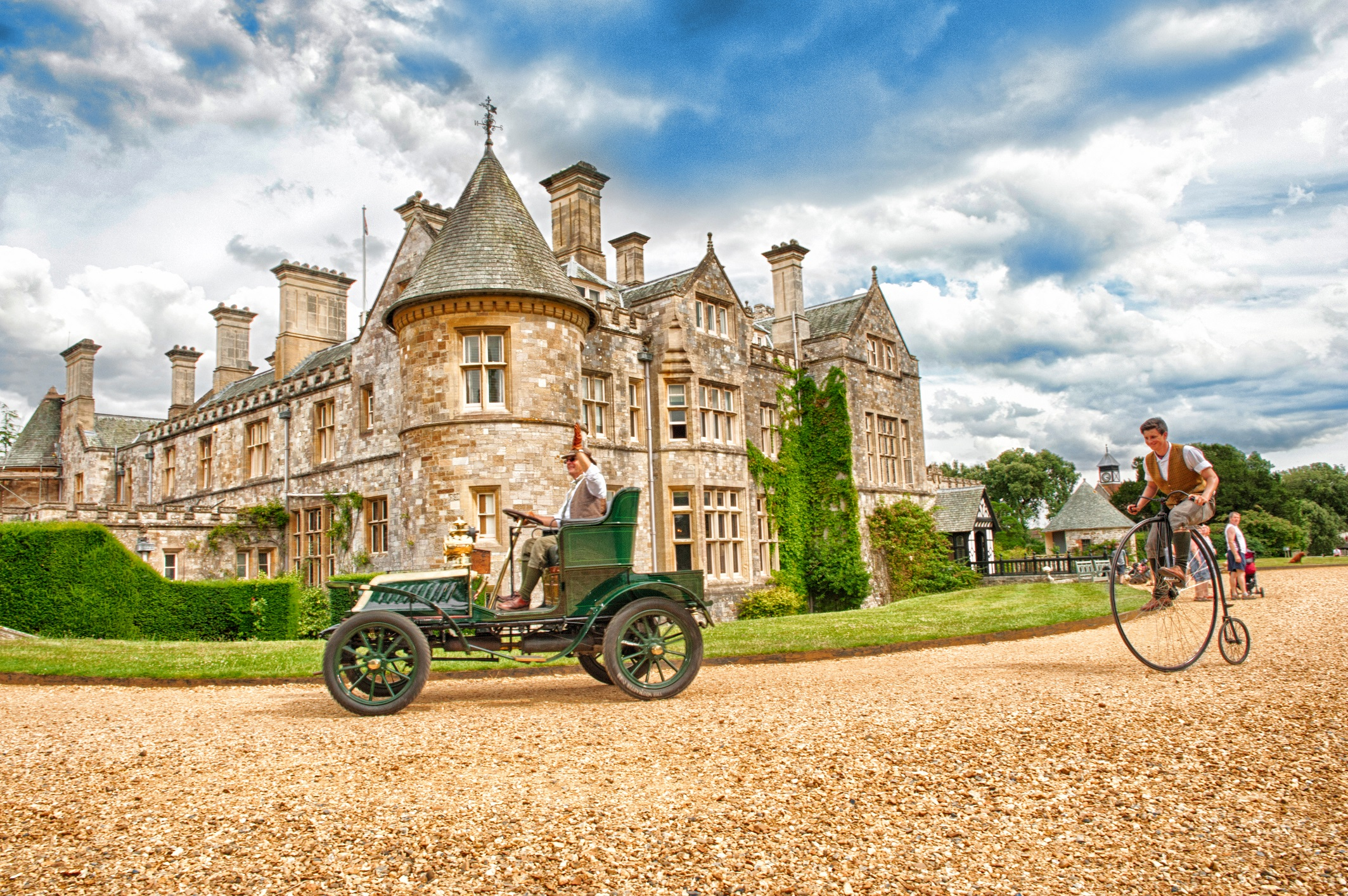 Palace House Beaulieu with vintage car and penny farthing in foreground