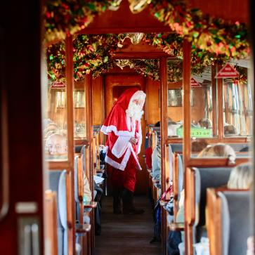 Father Christmas in a decorated railway carriage