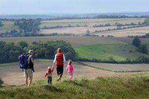 Family walking on Old Winchester Hill