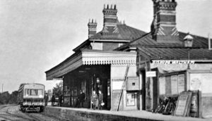 A historic photo of the railway station in Bishop's Waltham with a train at the platform