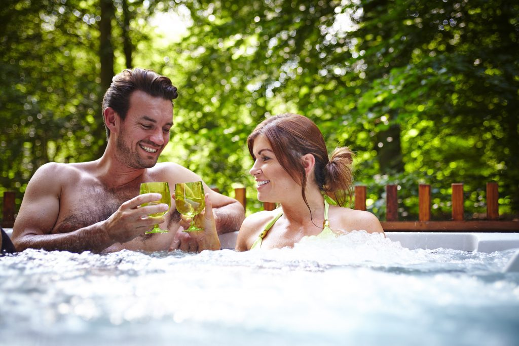 A couple enjoying a Hot Tub at Blackwood Forest