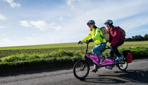 A couple on a tandem bike in the Hampshire countryside