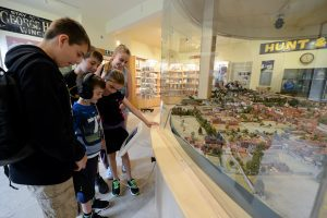 Children looking at Roger Brown model of Winchester - City Museum