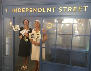 Shopfront with ladies from Winchester Tourist Information Centre