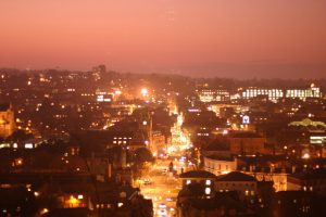 Sunset over Winchester with the high street lit up with street lights