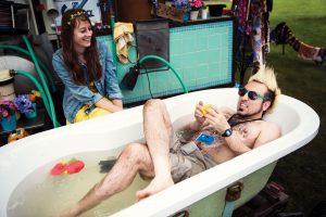 Hat Fair 2016 man laid in a bath outside