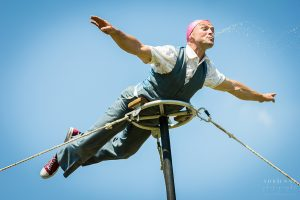 Hat Fair 2015 - artist suspended in the air spitting water