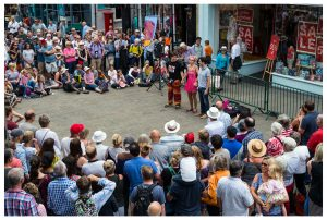 Hat Fair 2017 crowds gathered around a performance on the high street