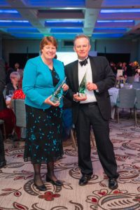 Wallops Wood 2.Owners Katherine and Andrew Graham at the Beautiful South Awards in December 2019 with the Gold Awards for Accessibility and Inclusivity, and Self-Catering Accommodation of the Year, for the South East region