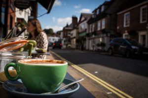 A cup of coffee and a view down the street in Bsihops Waltham