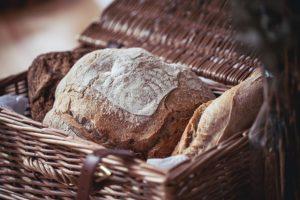 Fresh loaf of sourdough in a basket